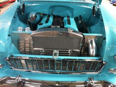 57 chev fan cover, intake pipe and over flow bottles